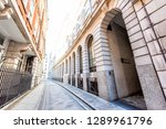 Small photo of London, UK Ironmonger lane narrow alley street by Bank of England and Royal Exchange exterior architecture in morning with tunnel arch called Prudent Passage