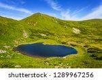 beautiful small lake among a... | Shutterstock . vector #1289967256
