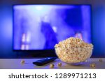 a glass bowl of popcorn and... | Shutterstock . vector #1289971213