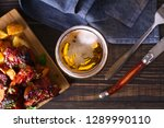 glass of beer and grilled pork... | Shutterstock . vector #1289990110
