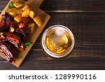 glass of beer and grilled pork... | Shutterstock . vector #1289990116