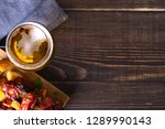 glass of beer and grilled pork... | Shutterstock . vector #1289990143