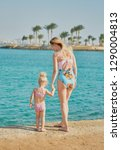 mom with her daughter in... | Shutterstock . vector #1290004813