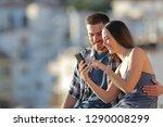 happy couple browsing smart... | Shutterstock . vector #1290008299