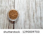coriander seeds on a wooden... | Shutterstock . vector #1290009703