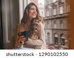 interested girl with curly... | Shutterstock . vector #1290102550
