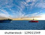 Tanker At Sea Towed By Tug.