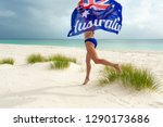 woman in bikini running along... | Shutterstock . vector #1290173686