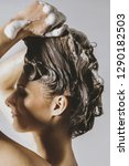 woman washing her blond hair... | Shutterstock . vector #1290182503