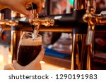 hand of bartender pouring a...   Shutterstock . vector #1290191983