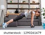 focused sportswoman exercising... | Shutterstock . vector #1290261679