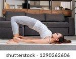 woman practicing bridge pose at ... | Shutterstock . vector #1290262606