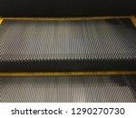 escalator or a moving walkway   ... | Shutterstock . vector #1290270730