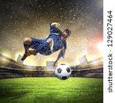 football player in blue shirt... | Shutterstock . vector #129027464