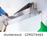 disassemble and clean air... | Shutterstock . vector #1290276463