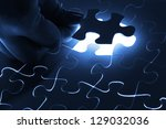 puzzle piece coming down into... | Shutterstock . vector #129032036