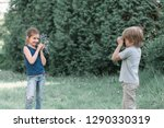 little boy takes a picture of... | Shutterstock . vector #1290330319