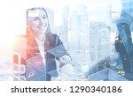 cheerful businesswoman shaking...   Shutterstock . vector #1290340186