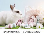 white bunny and easter eggs and ...   Shutterstock . vector #1290392209