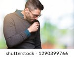 young handsome man wearing... | Shutterstock . vector #1290399766