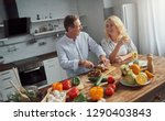 senior couple is cooking on... | Shutterstock . vector #1290403843