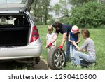 man replaces a damaged tire of... | Shutterstock . vector #1290410800