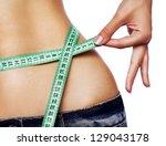 hand measuring waist | Shutterstock . vector #129043178