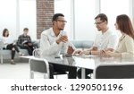 business colleagues discussing... | Shutterstock . vector #1290501196