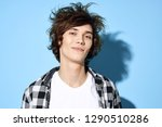 a man with disheveled hair and...   Shutterstock . vector #1290510286
