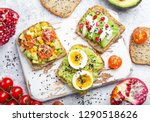avocado toasts with egg ... | Shutterstock . vector #1290518626
