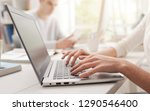 woman using a laptop and... | Shutterstock . vector #1290546400