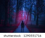 girl stand on the scary road in ...