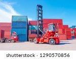 forklift trucks are handling at ... | Shutterstock . vector #1290570856