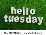 Small photo of Hello tuesday made from concrete alphabet