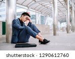 despair sad businessman sit on...   Shutterstock . vector #1290612760