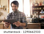 smiling woodworker sitting in... | Shutterstock . vector #1290662533