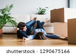 a young couple with cardboard... | Shutterstock . vector #1290675166