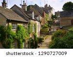 quaint cotswold cottages lining ...   Shutterstock . vector #1290727009