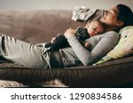 side view of a woman lying on... | Shutterstock . vector #1290834586
