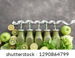 row of green bottled smoothies... | Shutterstock . vector #1290864799