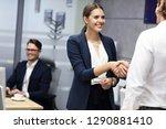 business people shaking hands... | Shutterstock . vector #1290881410