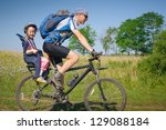 family cycling in summer   Shutterstock . vector #129088184
