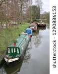 narrow boats moored up at... | Shutterstock . vector #1290886153