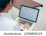 businesswoman wearing glasses... | Shutterstock . vector #1290890119