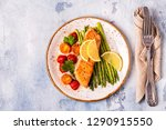 grilled salmon with asparagus... | Shutterstock . vector #1290915550