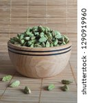 cardamom in a wooden bowl. | Shutterstock . vector #1290919960