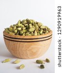 cardamom in a wooden bowl. | Shutterstock . vector #1290919963