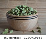 cardamom in a wooden bowl. | Shutterstock . vector #1290919966