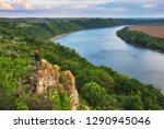 tourist on the rock. girl... | Shutterstock . vector #1290945046