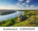 tourist on the rock. girl... | Shutterstock . vector #1290945049